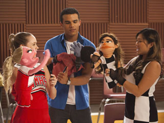 "GLEE: Kitty (Becca Tobin, L), Jake (Jacob Artist, C) and Tina (Jenna Ushkowitz, R) play with their new puppets in the ""Puppet Master"" episode of GLEE airing Thursday, Nov. 28 (9:00-10:00 PM ET/PT) on FOX. ©2013 Fox Broadcasting Co. CR: Adam Rose/FOX"